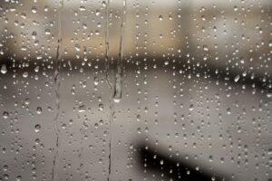 Rain water dripping over a window
